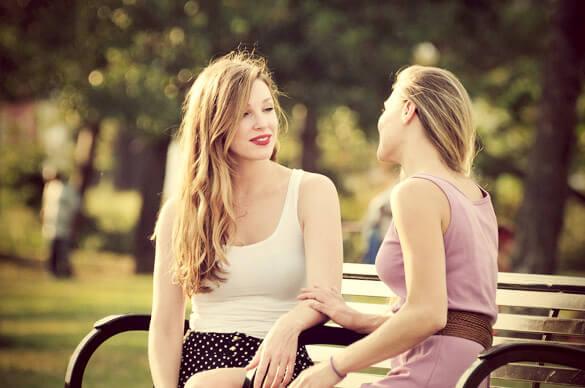 good-friends-having-a-heart-to-heart-talk-out-on-a-park-bench.jpg