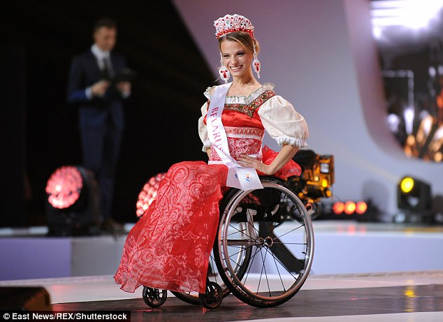 452A948F00000578-4962902-She_also_wore_traditional_Belarusian_dress_during_the_contest-a-70_1507559074560.jpg