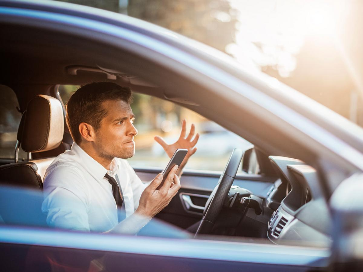 1280-man-angry-phone-car-driving.jpg