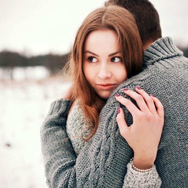 635959367393999898-1982660437_Girl-hugging-guy-looking-away-980x980.jpg