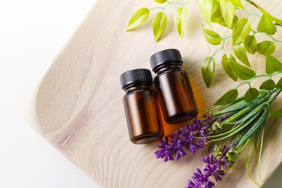 BEAUTIFUL-ESSENTIAL-OILS-in-amber-bottles-and-plants.jpg