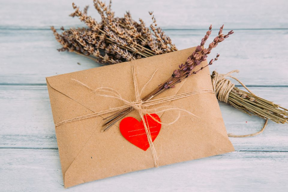 envelope-with-heart-sticker-and-dried-flowers-709118369-5a6363404e46ba003741167d.jpg