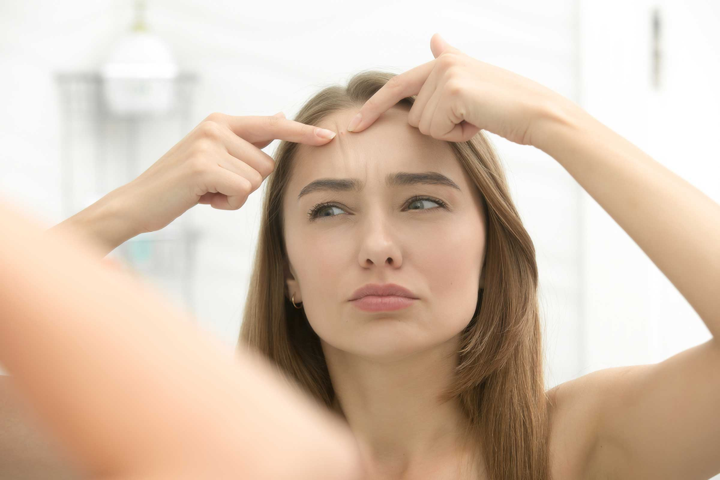 01-Little-Body-Changes-that-Reveal-a-Lot-About-Your-Health-pimple-625205966_fizkes.jpg