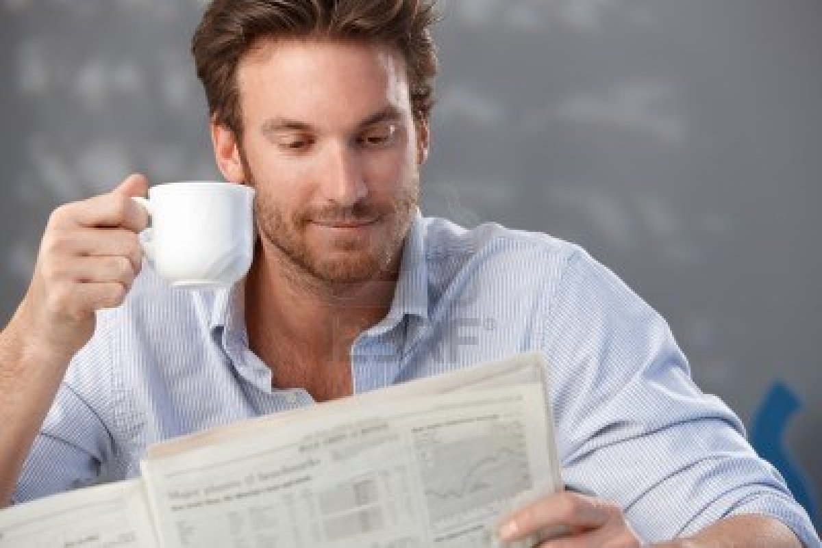 morning-portrait-of-handsome-guy-reading-newspaper-and-holding-coffee-cup.jpg