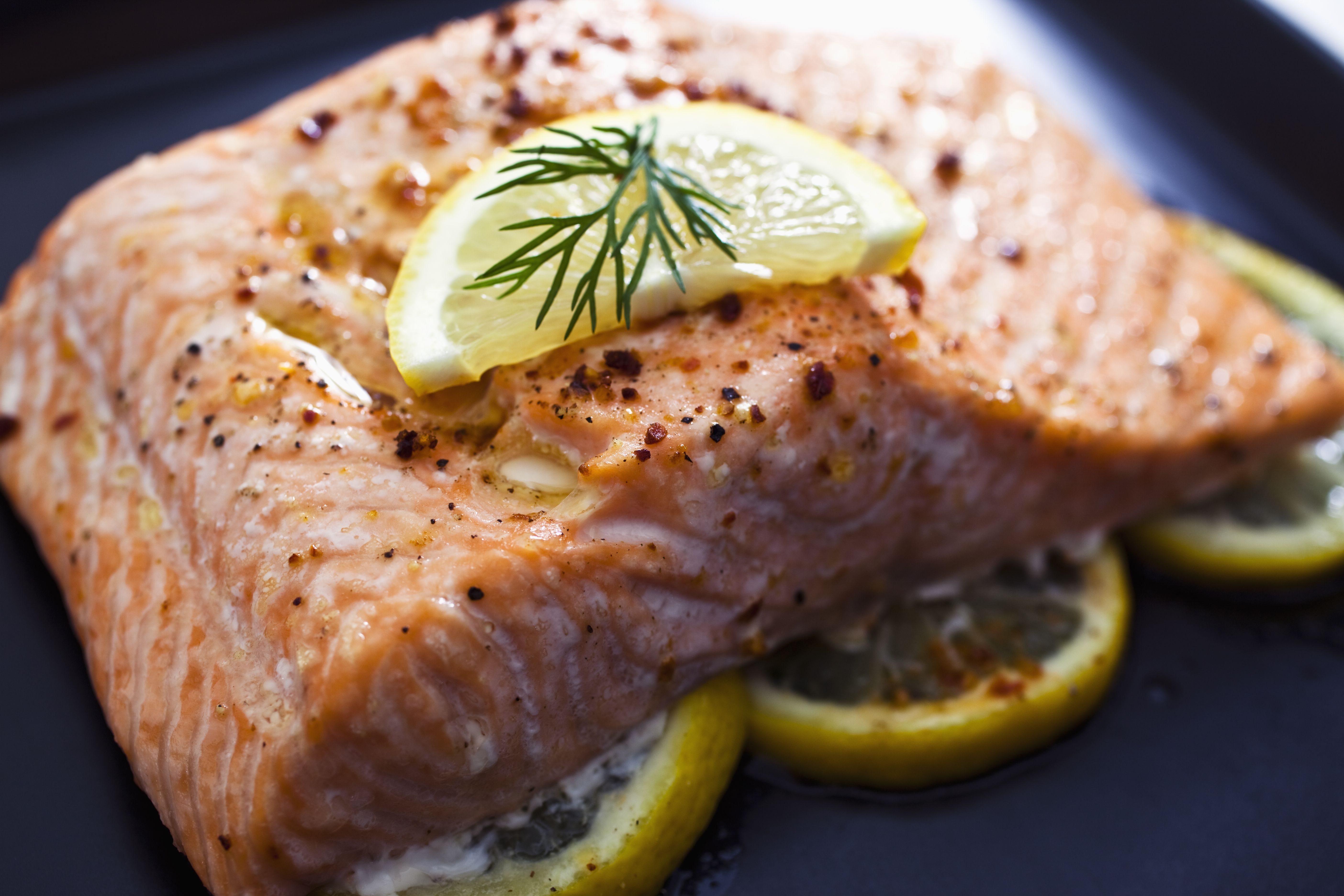 baked-salmon-with-a-slice-of-lemon-and-some-dill-157505475-5835f7cc3df78c6f6ad3d072.jpg