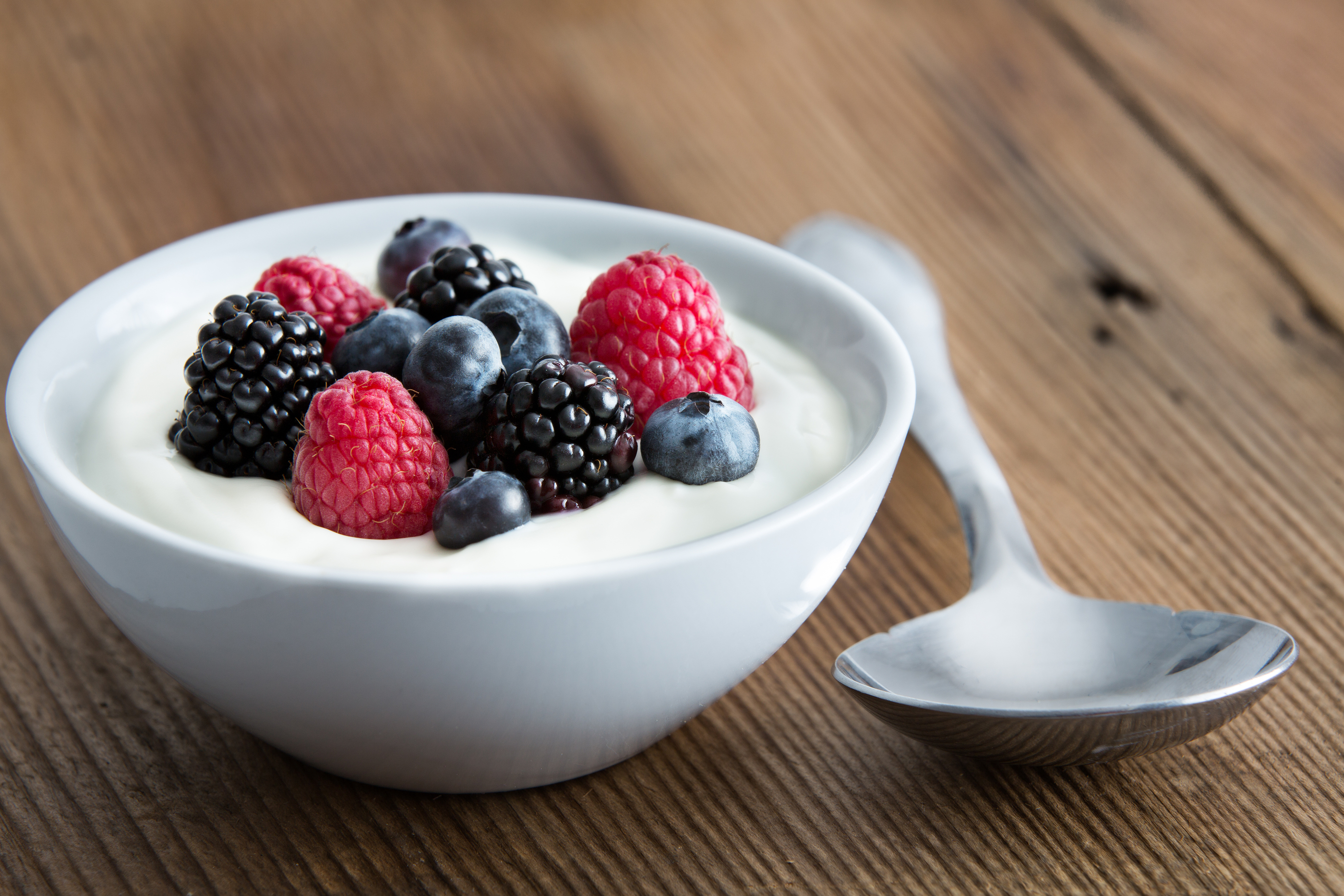 bigstock-Bowl-Of-Fresh-Mixed-Berries-And-yogurt-58971671.jpg