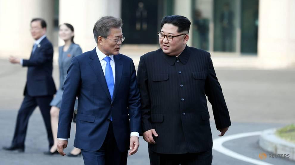file-photo---south-korean-president-moon-jae-in-and-north-korean-leader-kim-jong-un-walk-together-at-the-truce-village-of-panmunjom-1.jpg