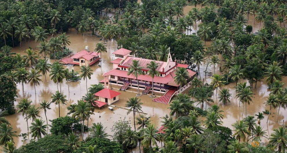 an-aerial-view-shows-partially-submerged-houses-at-a-flooded-area-in-the-southern-state-of-kerala-5.jpg