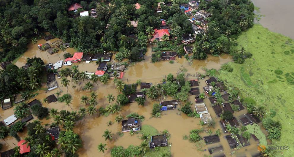 an-aerial-view-shows-partially-submerged-houses-at-a-flooded-area-in-the-southern-state-of-kerala-3.jpg