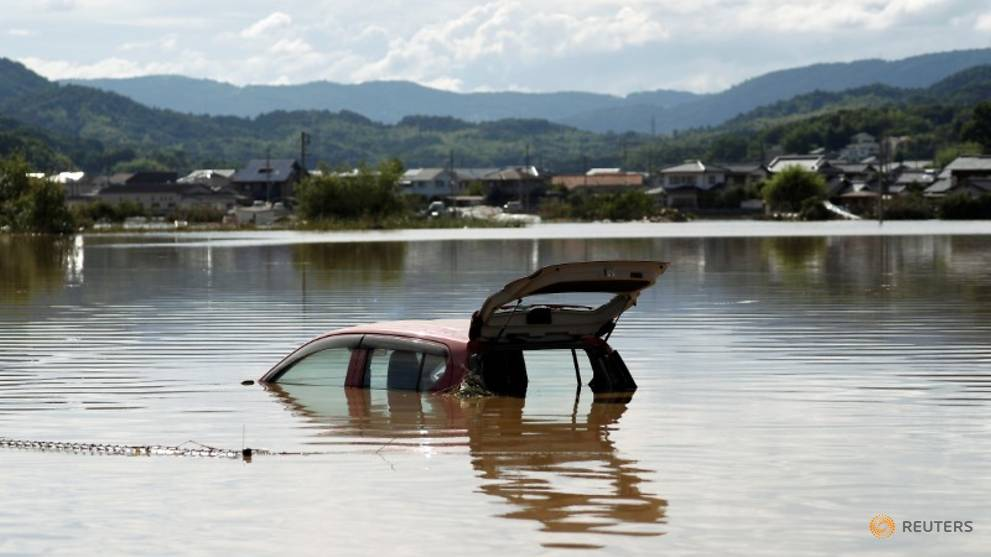 a-car-is-submerged-at-a-flooded-area-in-mabi-town-in-kurashiki-5.jpg