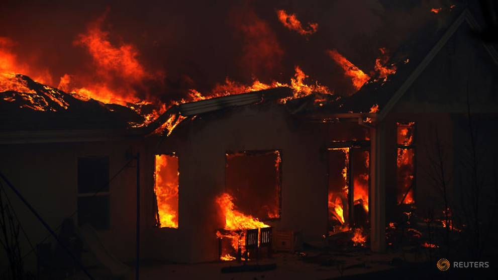 a-home-is-engulfed-in-flames-during-the-camp-fire-in-paradise-1.jpg