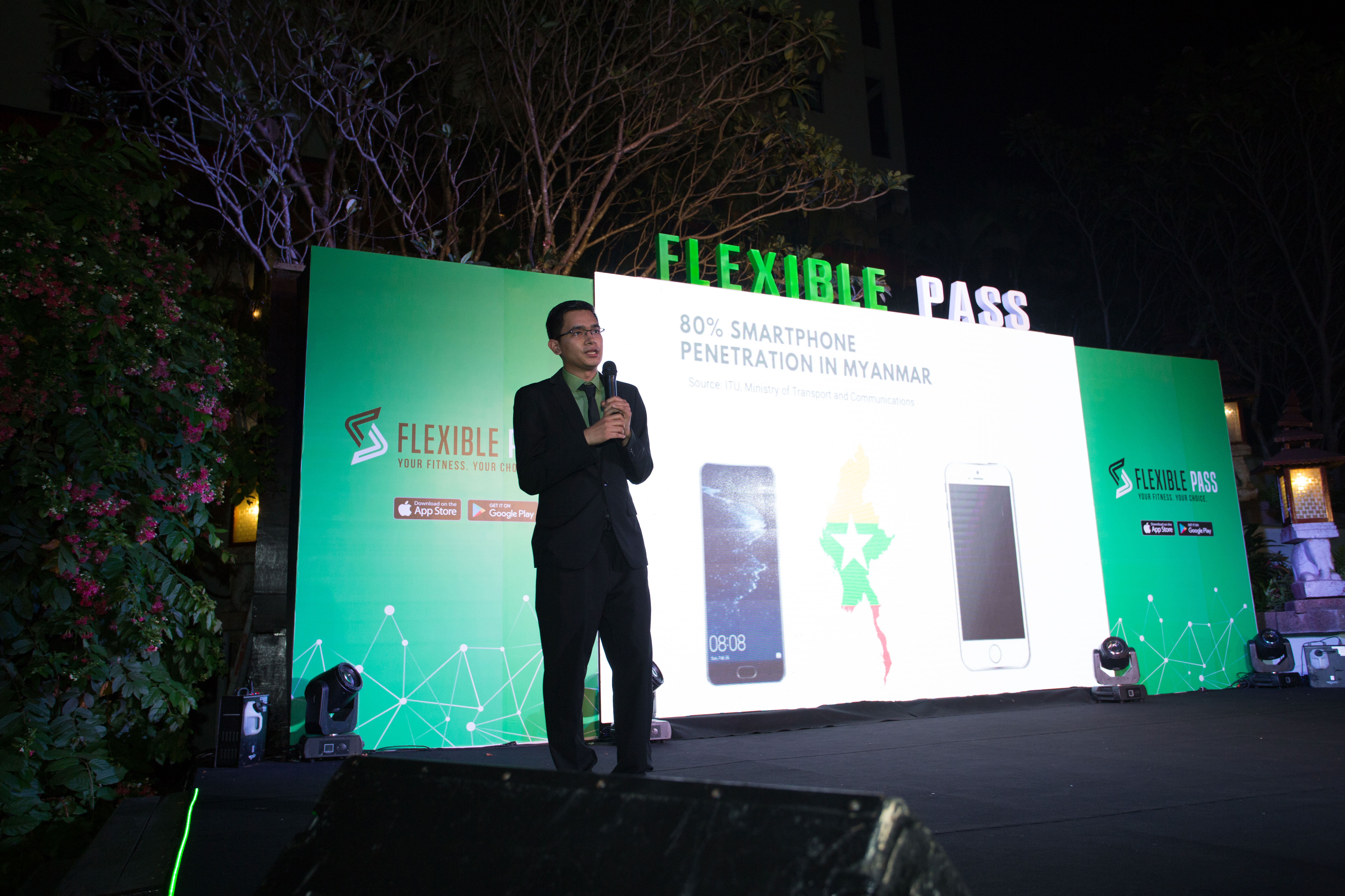 Flexible-Pass-founder-Sully-speaking-on-stage-of-Flexible-Pass's-1-year-anniversary-event.jpg