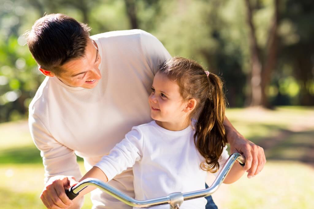 bigstock-happy-young-father-riding-bicy-65211064-1024x683.jpg