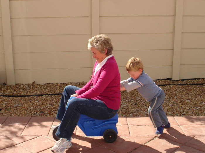 Child_pushing_grandmother_on_plastic_tricycle-700x525.jpg