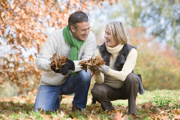 bigstockphoto_Couple_Playing_In_Leaves_3915079.jpg