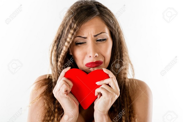53464430-Beautiful-unhappy-girl-crying-and-holding-broken-red-heart-Valentine-s-Day-concept--Stock-Photo.jpg