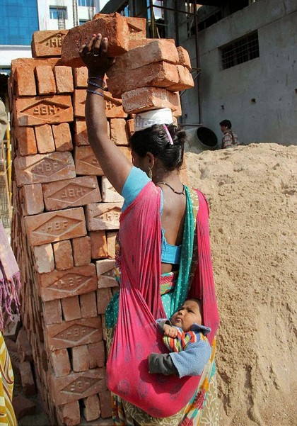 3E18895300000578-0-A_hardworking_mother_carries_Carrying_six_bricks_on_your_head_is-a-2_1489044385041.jpg